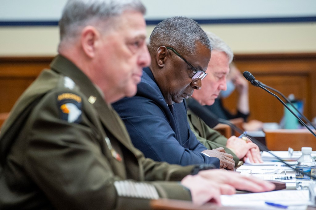 Chairman of the Joint Chiefs of Staff Gen. Mark Milley, Defense Secretary Lloyd Austin and Gen. Kenneth McKenzie, commander of the United States Central Command testify during the House Armed Services Committee on the conclusion of military operations in Afghanistan
