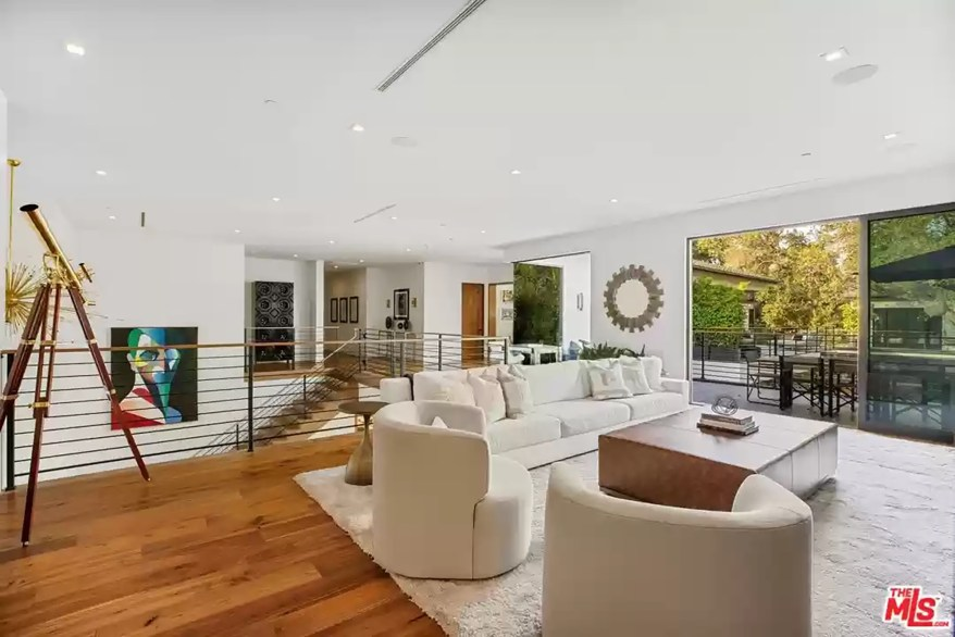 A living room in the LA house is pictured from a third angle.