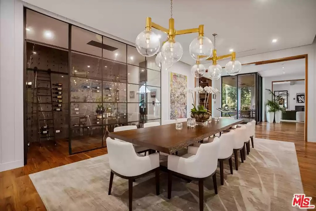The wine cellar and dining room in the Los Angeles house is pictured.
