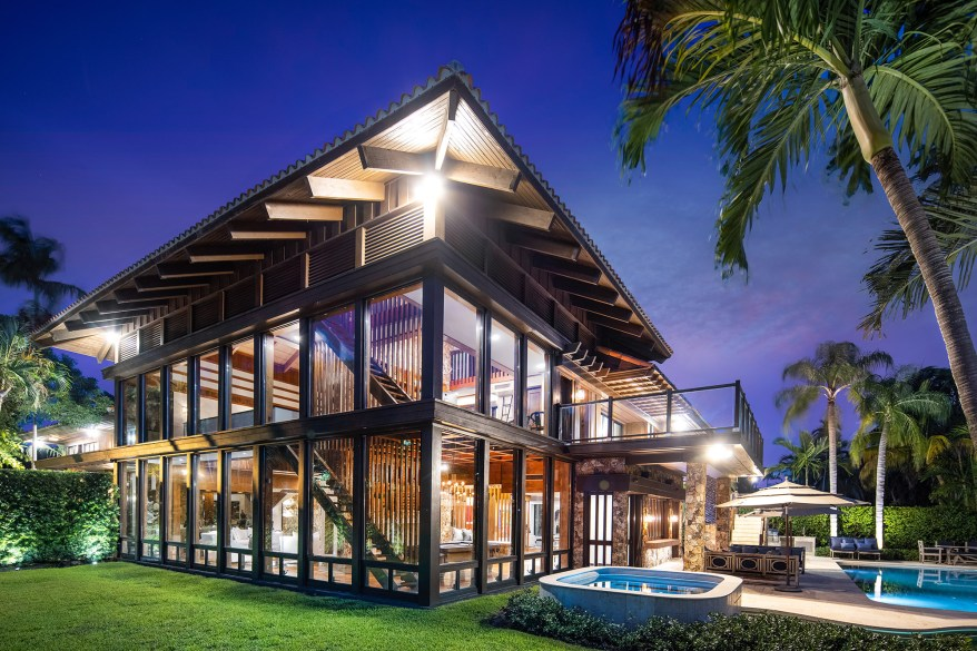 The Miami home is pictured at night.