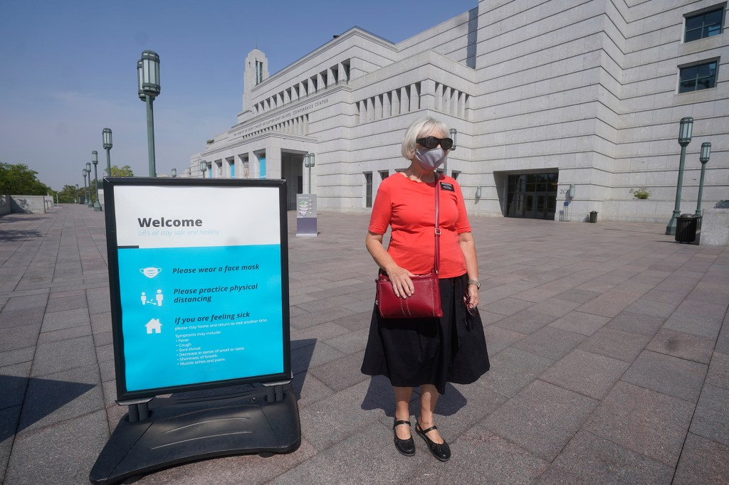In this Aug. 26, 2021, file photo, The Church of Jesus Christ of Latter-day Saints church member Rebecca Richards wears a mask outside the The Church of Jesus Christ of Latter-day Saints Conference Center in Salt Lake City.