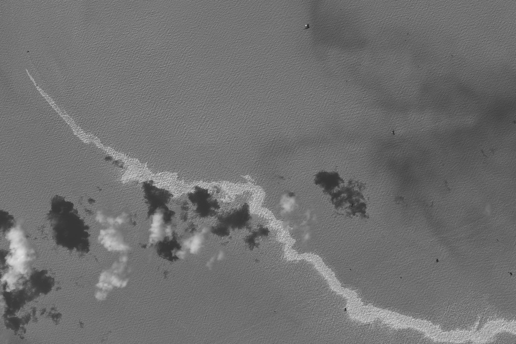 A black and white satellite image shows an oil spill following the landing of Hurricane Ida south of Port Fourchon, Louisiana on September 2, 2021.