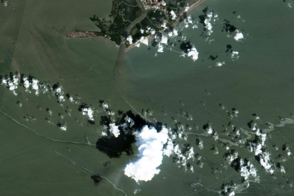 A satellite image from Maxar Technologies shows oil spills from the Gulf of Mexico off the coast of Louisiana.