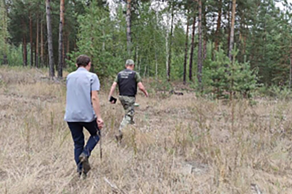 Russian law enforcement searches for Oleg Sviridov's body near the Vintai village in Samara, Russia.