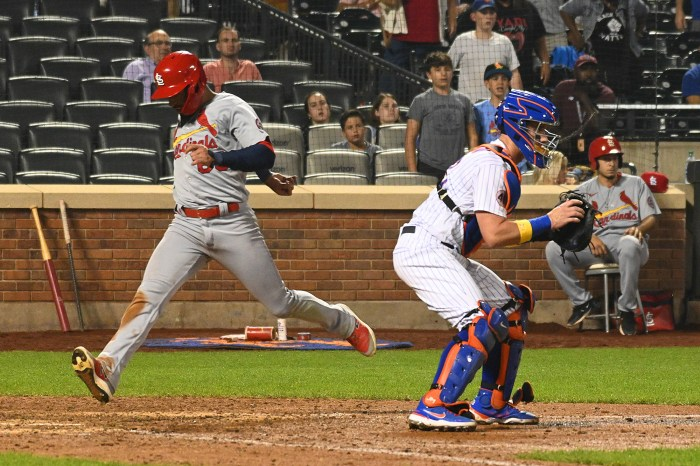 The Mets fell to the Cardinals in extra innings Tuesday.