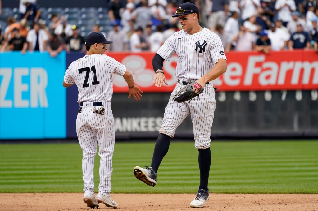 Yankees shortstop Andrew Velazquez celebrates with Aaron Judge after the Yankees defeated the Minnesota Twins on Saturday, Aug. 21, 2021 at Yankee Stadium.