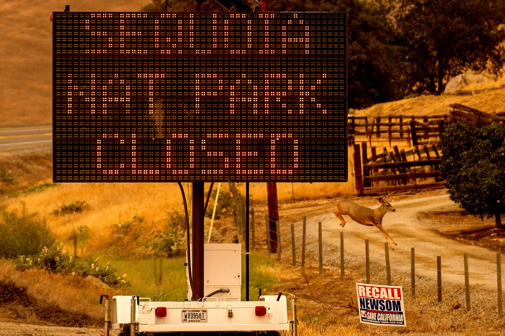 A sign announces the closure of Sequoia National Park, where the KNP Complex Fires are burning, Tuesday, Sept. 14, 2021, in Tulare County, Calif.