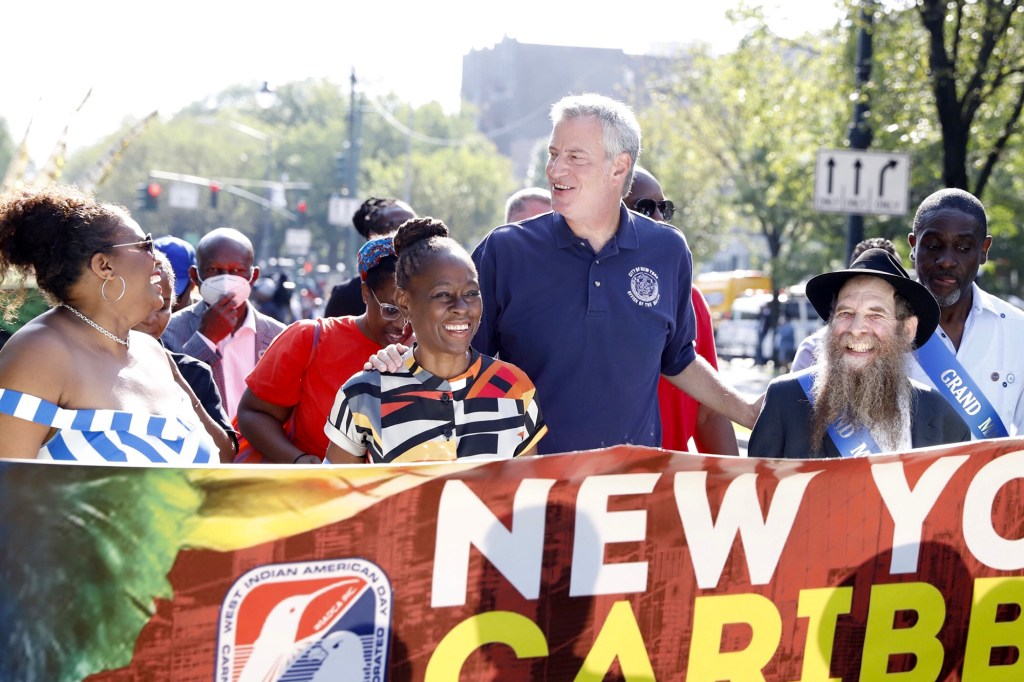 Mayor Bill de Blasio marching with First Lady Chirlane McCray and Rabbi Eli Cohen (R) as part of the scaled down West Indian Day Parade