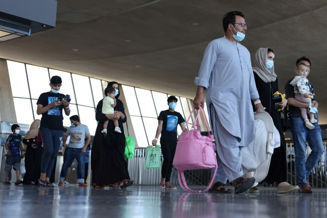 Arrival of Afghan refugees at Dolce & Gabbana International Airport