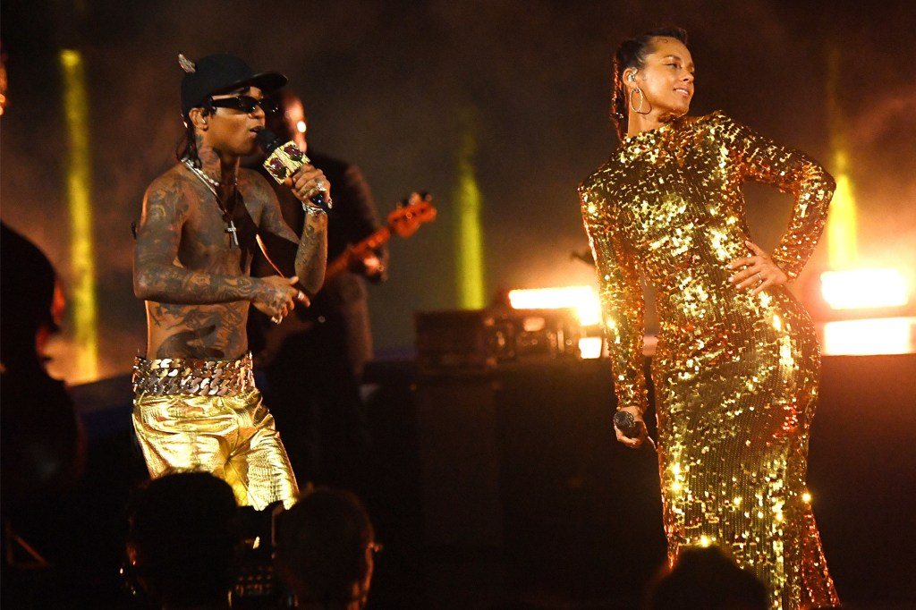 Swae Lee and Alicia Keys perform onstage at Liberty State Park in Jersey City for the 2021 MTV Video Music Awards.