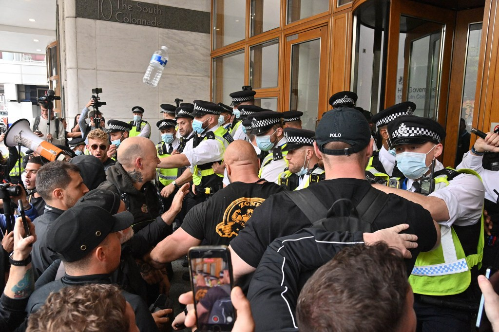 Anti Lockdown and anti Covid vaccination protesters  remonstrate with police officers in a demonstration in Cabot Square office in Canary Wharf calling for an end to mandatory vaccination passports and vaccination of teenagers
