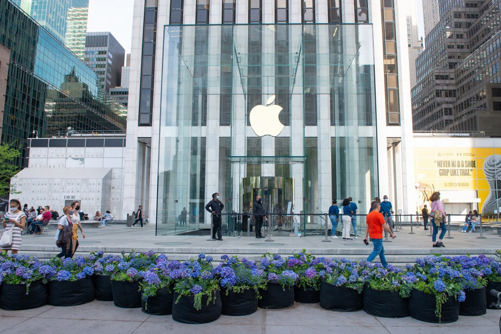 Flowers are displayed outside the Apple Store at the Fifth Avenue Blooms Mother's Day installation along Fifth Avenue amid the coronavirus pandemic on May 2, 2021 in New York City. The annual event which was cancelled in 2020 due to the coronavirus pandemic has returned. It  consists of ten large rivers of flowers, 999 planted grow bags in total, 7,000 flowers and 17,000 gallons of soil; each block is a different color palette. The installation runs until May 14th.