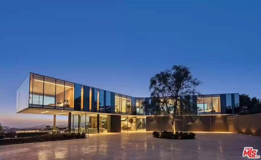"""""""Given its prominent positioning above a relatively developed neighborhood, the motivation behind the design of the home was to create a residence that could meld into its surroundings while maximizing views,"""" Pali's firm wrote on its website."""