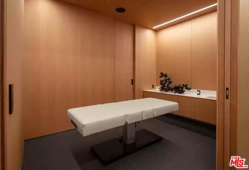 The house is packed with amenities, including a massage room.
