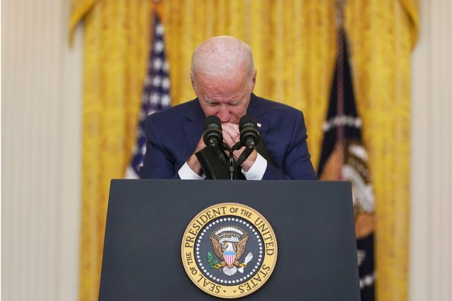 President Joe Biden whimpers while delivering remarks on the Kabul airport attack and 13 US service members being killed in the White House on August 26, 2021.
