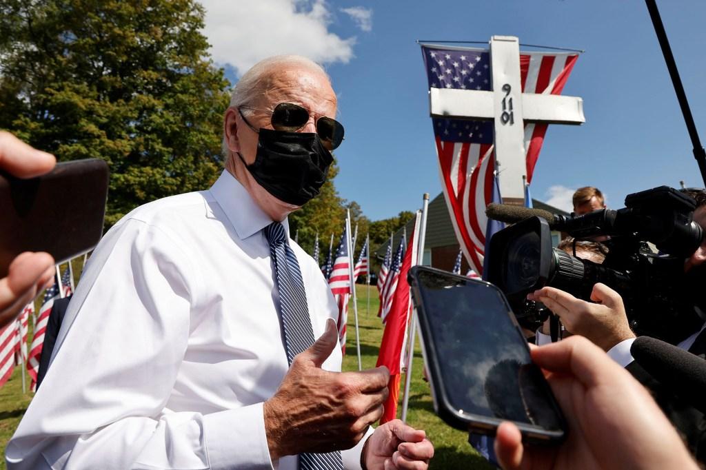 U.S. President Joe Biden talks with reporters outside the Shanksville volunteer fire station.