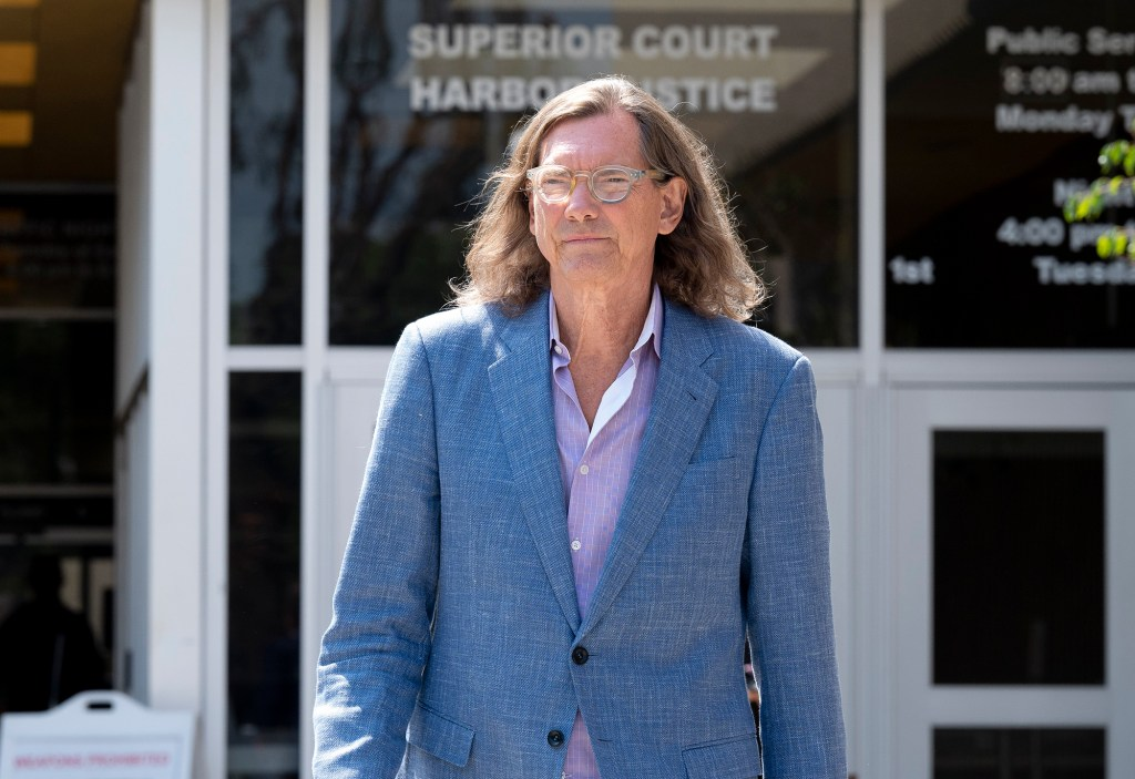 William Hutchinson, 63-year-old Texas real estate developer and reality tv personality, exits superior court in Newport Beach, CA on Tuesday July 13, 2021.