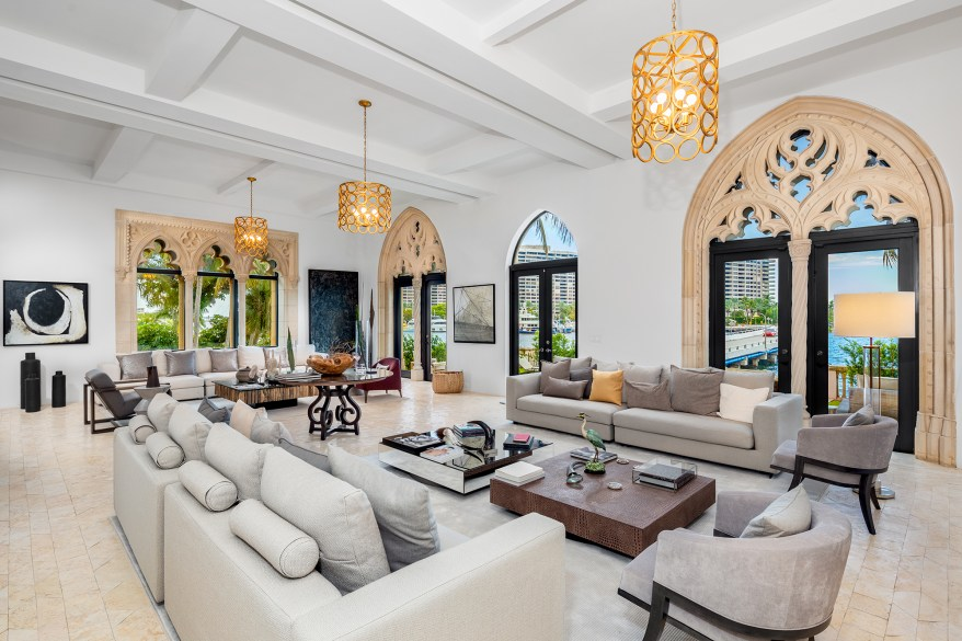 The gothic chapel-like home with peaked windows spans 12,000 square feet with six bedrooms and seven bathrooms.