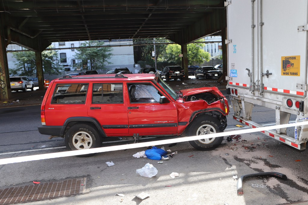 A 70-year-old man driving a red Jeep crashed into a parked tractor trailer on Third Avenue near 50th Street in Sunset Park, Brooklyn.