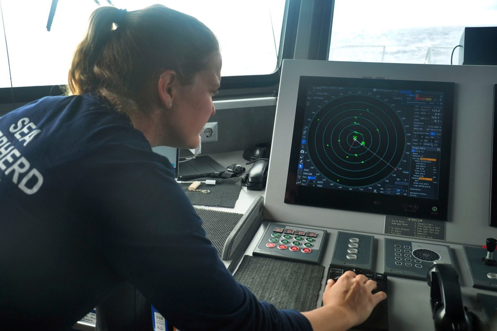 Carmen McGregor, second officer of the Ocean Warrior, checks the radar system on July 18, 2021, as part of the ship's 18-day voyage to observe up close the activities of the Chinese distant water fishing fleet off the west coast of South America.