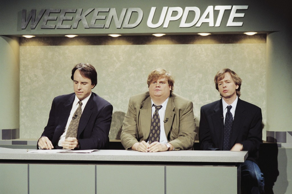 """Kevin Nealon, Chris Farley and David Spade during a 1994 episode of SNL's """"Weekend Update"""" segment."""