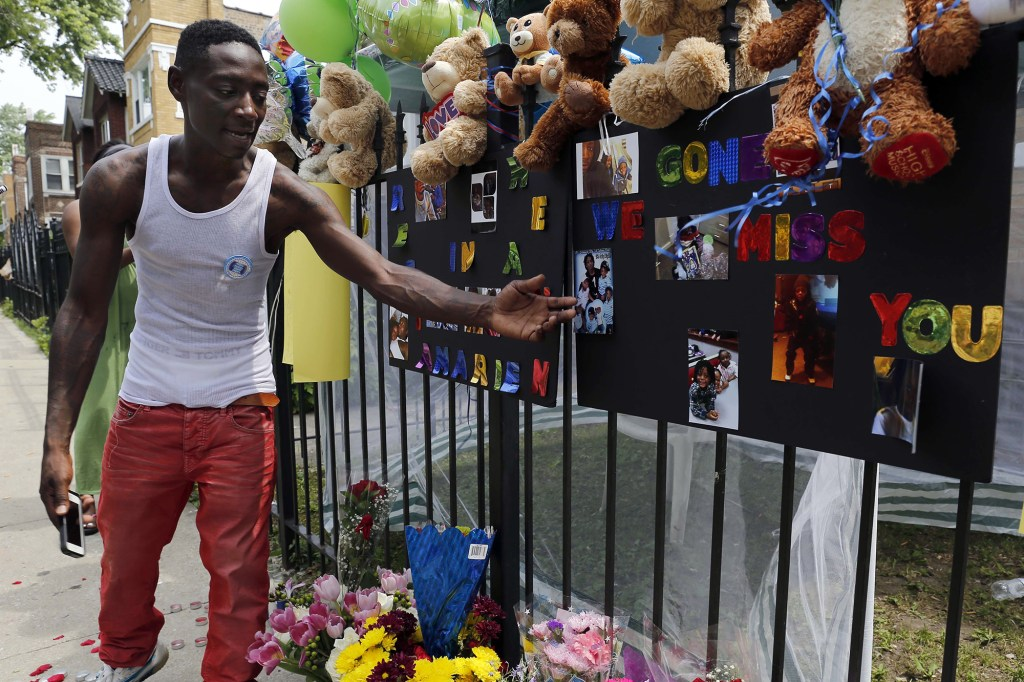Antonio Brown, father of Amari Brown, is seen near a sign honoring his son after his death in 2015.