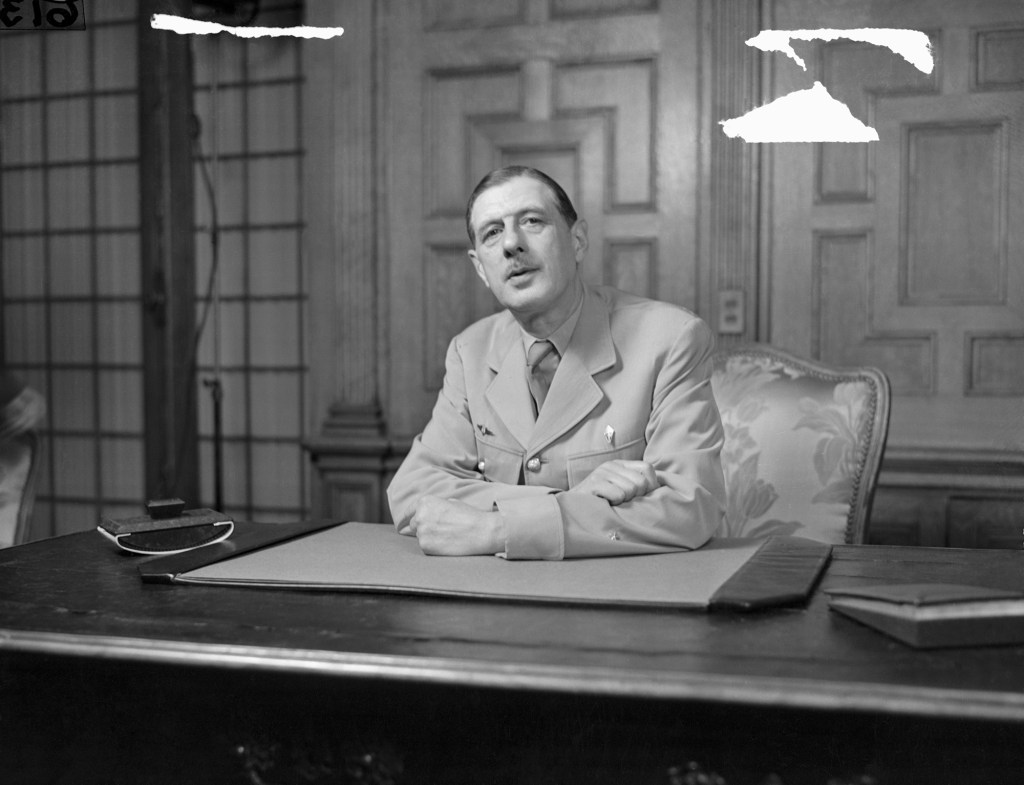 General De Gaulle At Press Confab. This is candid view of General Charles DeGaulle, President of the French Provisional Government, while talking to newsmen at press conference in Washington. He came to the U. S. to ask aid for his country in rebuilding to former status.
