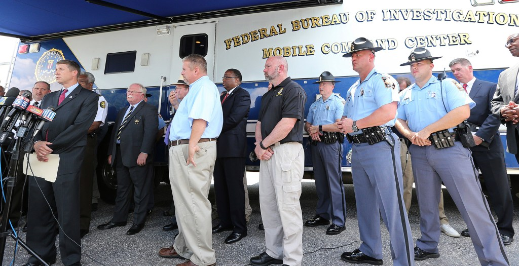Commissioner Greg Dozier, left, Georgia Department of Corrections, speaks to the news media during a joint press conference of all the agencies involved in the manhunt for the two escaped convicts Donnie Russell Rowe and Ricky Dubose, who shot and killed two correctional officers.