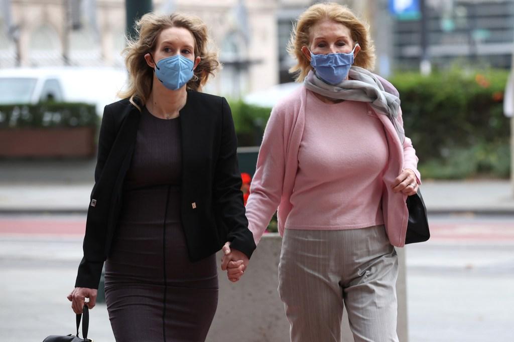 Elizabeth Holmes (left) and her mother Noel Holmes (right) arrive at the Robert F. Peckham Federal Building.