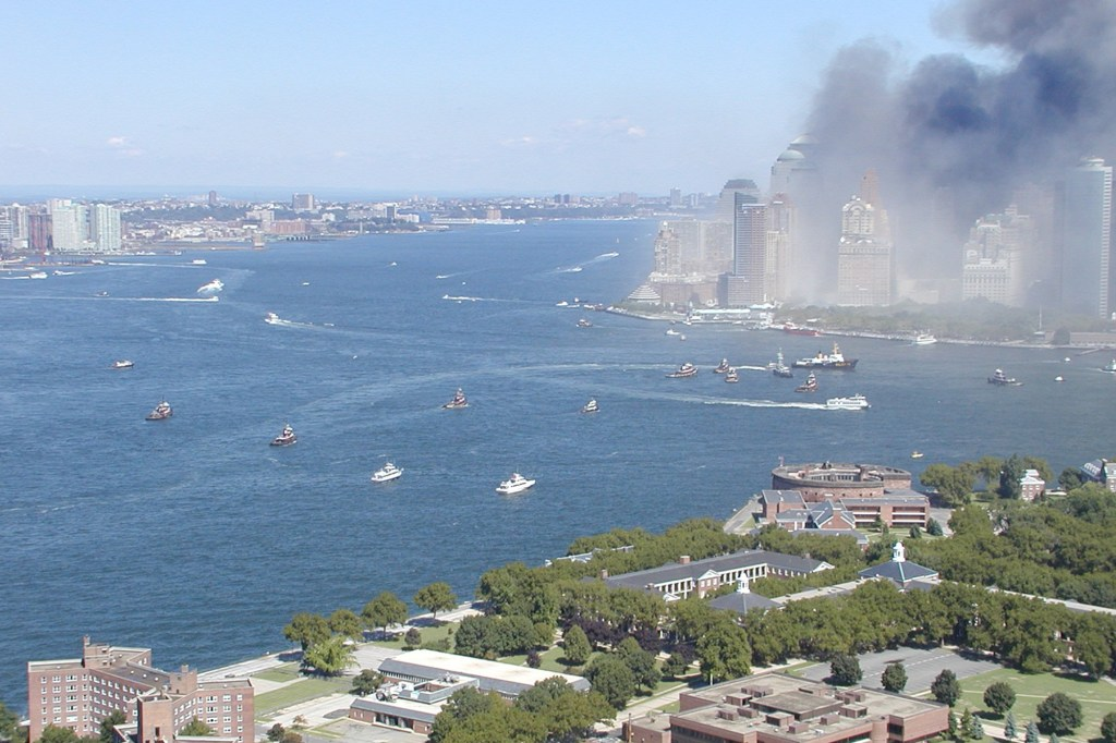 Hudson River rescue boats arrive at Manhattan to evacuate people from the September 11 terrorist attacks.