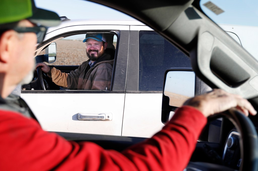 Tim Black, left, stops to talk to his son, Tyler, on their farm in Muleshoe, Texas, on Monday, April 19, 2021.