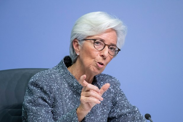 Christine Lagarde speaking in front of a microphone