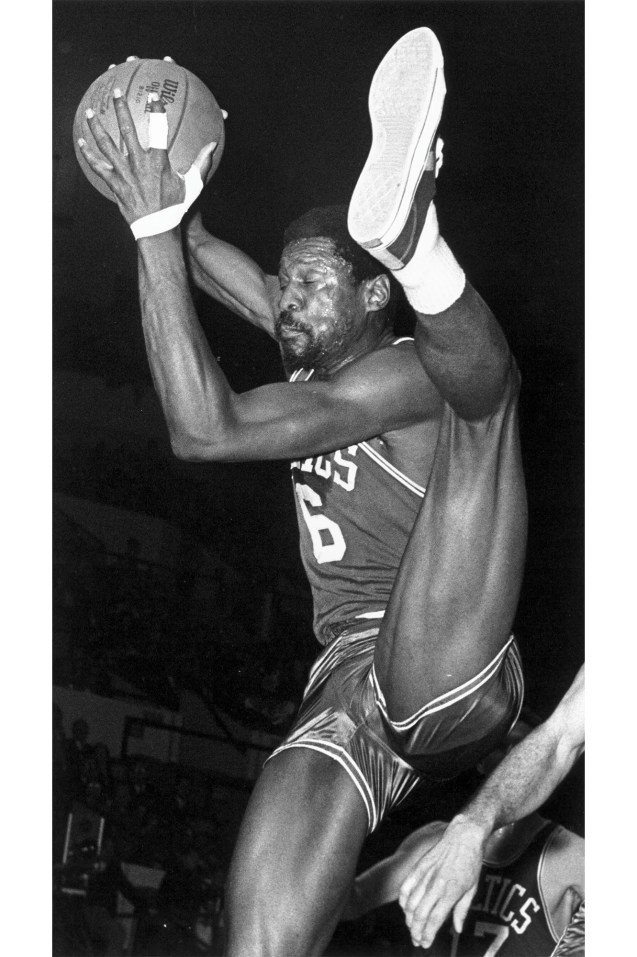 Bill Russell's incredible physique and flexibility are on display during a 1968 matchup against the Detroit Pistons.