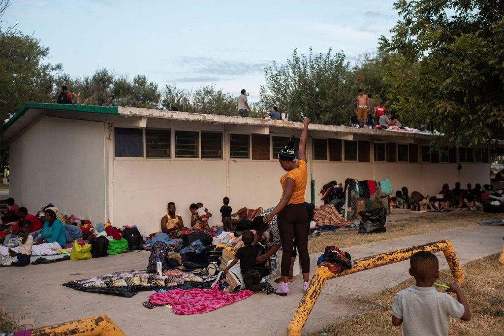 Haitian migrants begin to stir at an encampment at a sports park in Ciudad Acuna, Mexico.
