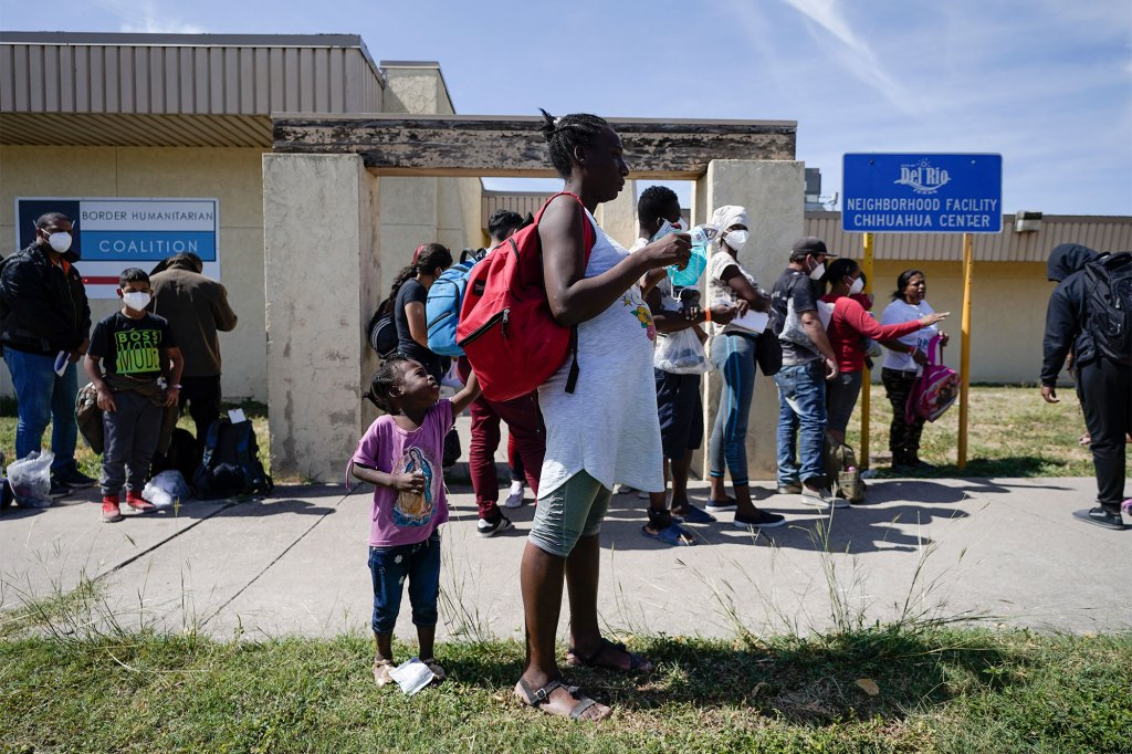 Migrants, many of whom are Haitian, wait to board a bus to Houston at a humanitarian center after they were released from United States Border Patrol upon crossing the Rio Grande.