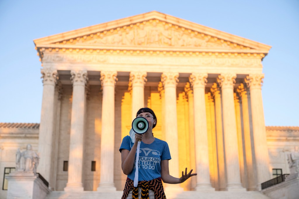 An activist speaks outside the Supreme Court in protest against the new Texas abortion law that prohibits the procedure around six weeks into a pregnancy.