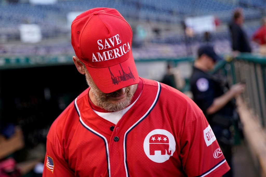 U.S. Representative Greg Steube (R-FL) wears a hat signed by former U.S. President Donald Trump during the annual Congressional Baseball game.