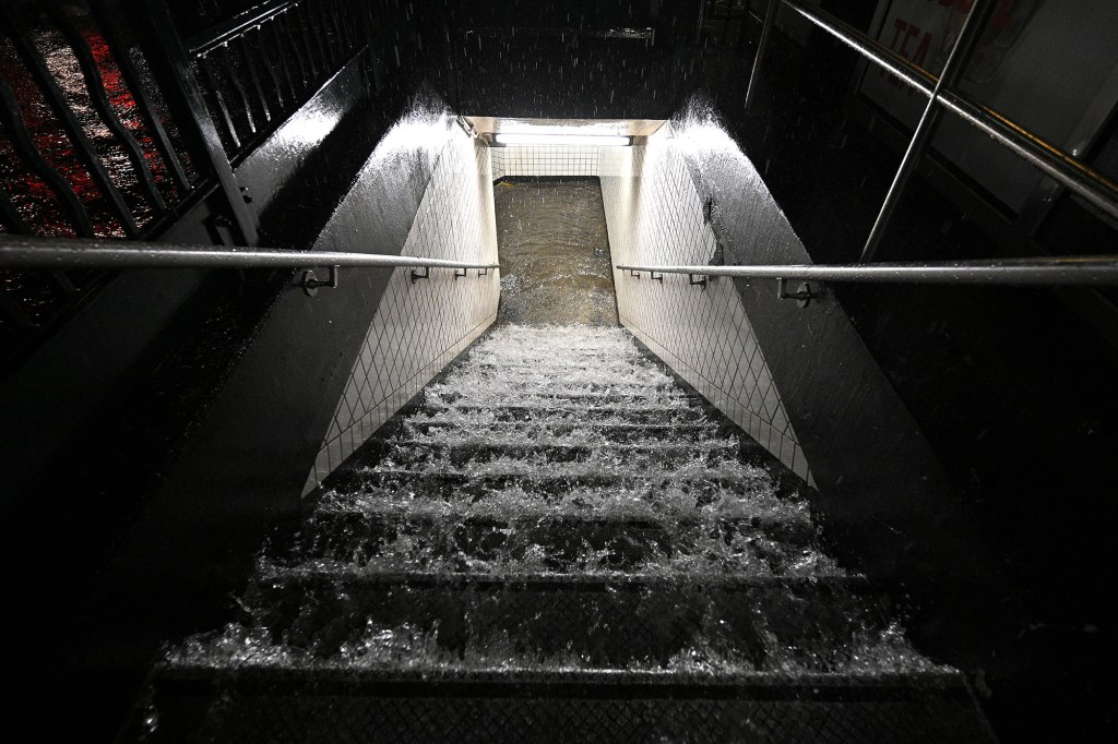 Flood waters cascade down subway steps as remnants of Hurricane Ida brought three inches of rain per hour across New York City on Sept. 1, 2021.