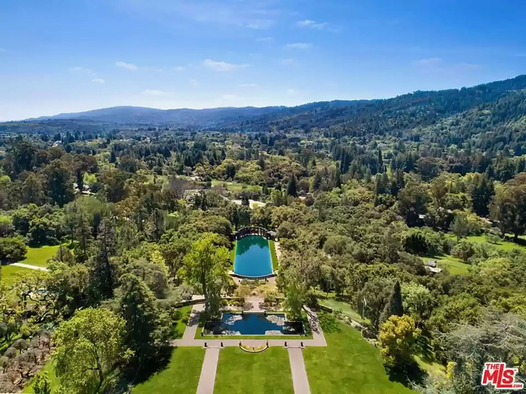 According to Realtor.com, the value of the estate she is living on is $135M.