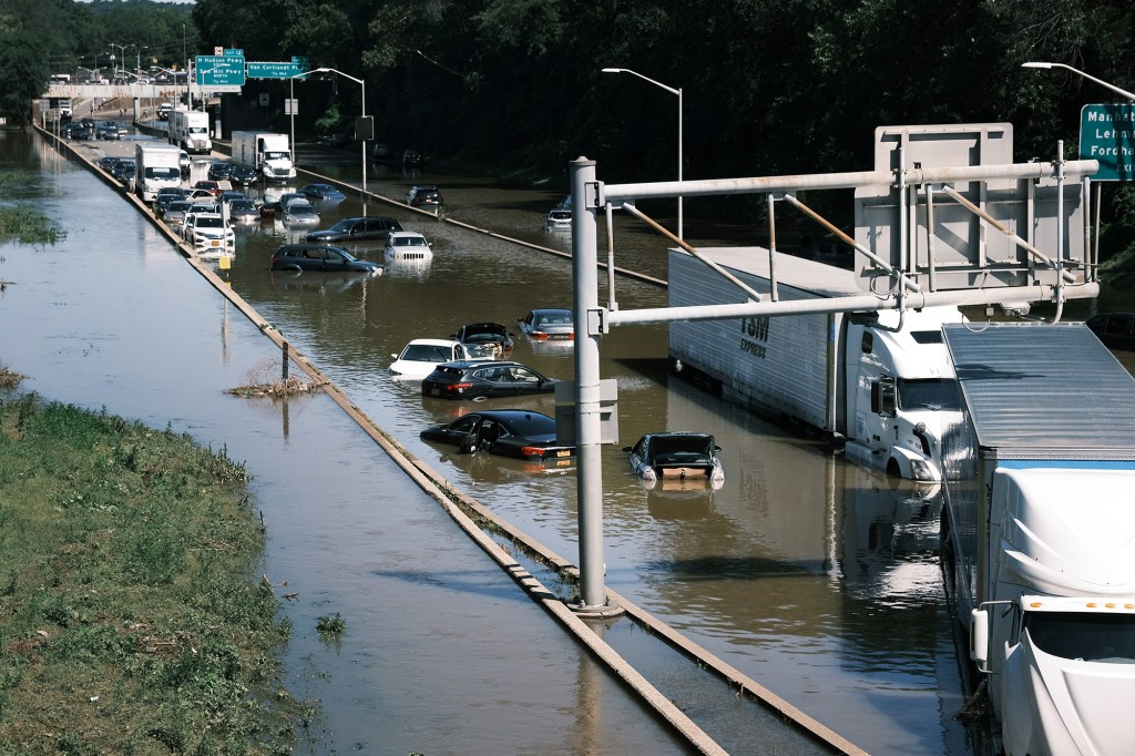 Cars sit abandoned on the flooded Major Deegan Expressway in the Bronx following a night of heavy wind and rain from the remnants of Hurricane Ida  on September 02, 2021 in New York City