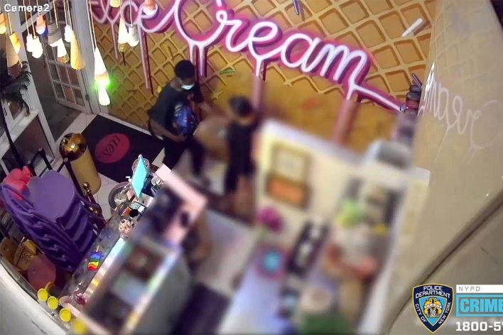A man assaults a woman in an Upper East Side ice cream shop.