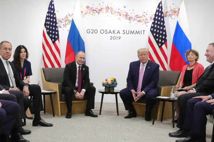 """Russian President Vladimir Putin reported used a very attractive female translator to """"distract"""" former President Donald Trump when the G20 summit in 2019 according to a new book."""