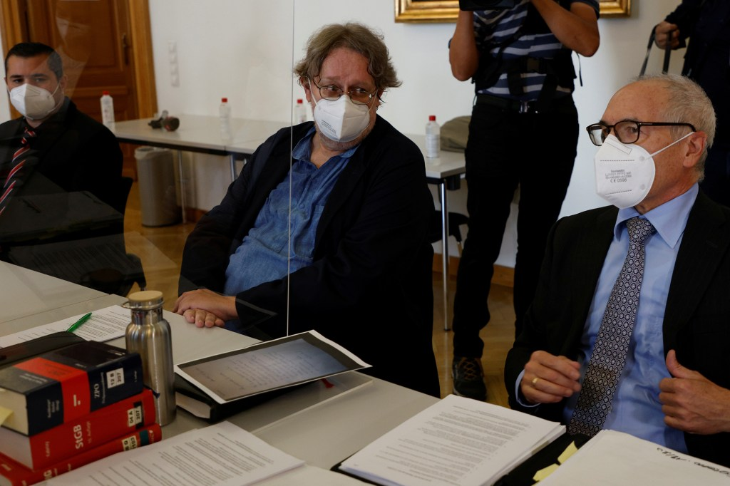 Lawyer Alexander Klauser and Chairman of the Consumer Protection Union Peter Kolba and their client Ulrich Schopf wait for the opening of civil trial over a man's death from COVID-19 after holiday in Ischgl ski resort, in Vienna, Austria September 17, 2021.
