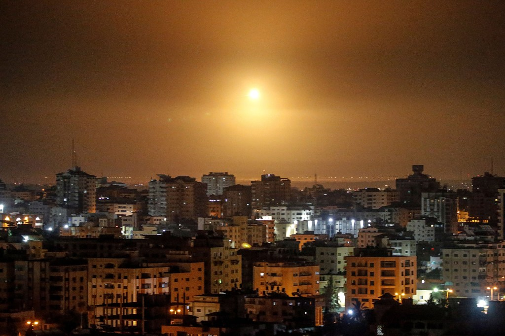 Streaks of light are seen as Israel's Iron Dome anti-missile system intercepts a rocket.