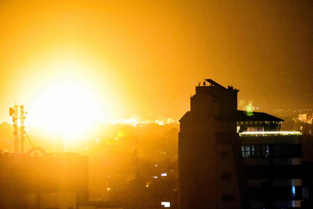A fireball rises following an air strike.