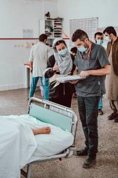 Alberto Zanin checks a patient's chart.