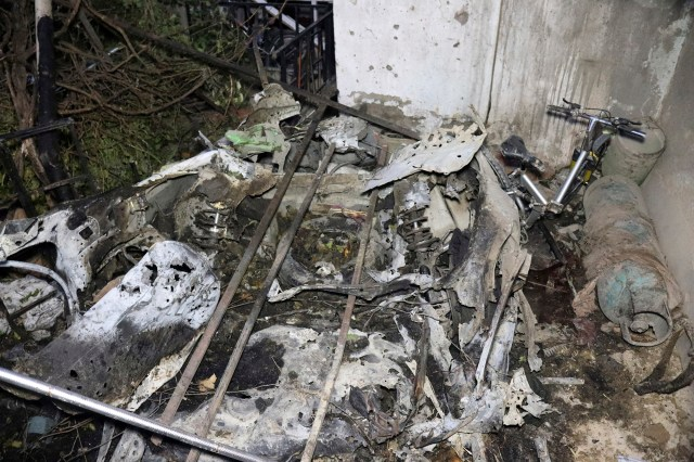 Parts of a destroyed vehicle is seen inside a house after the U.S. drone strike in Kabul.