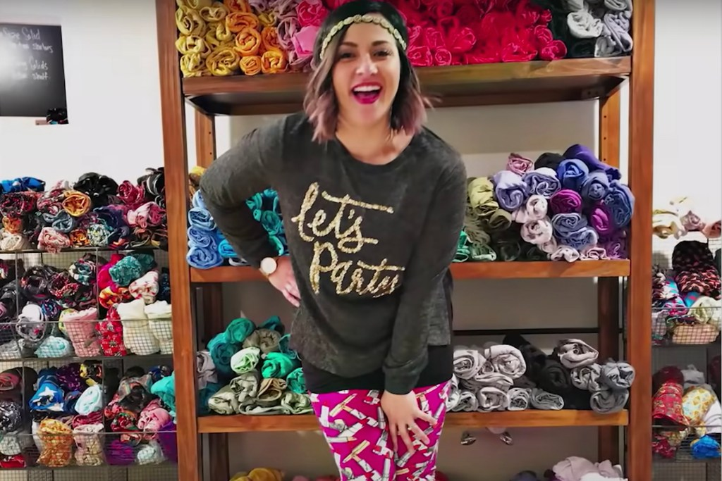 """Ashleigh Lautaha (here with LuLaRoe clothing she sold) says in the documentary """"LuLaRich"""" — about the crash and burn of the company — that she got so wrapped up in the brand's culture that it led to the collapse of her marriage."""