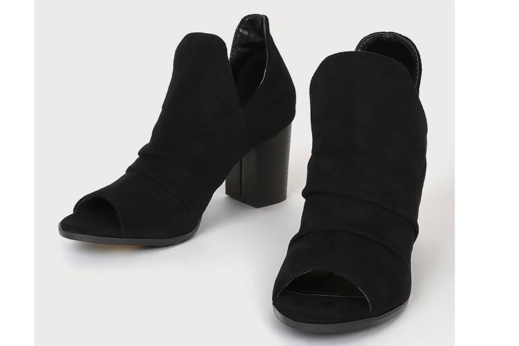 A pair of black booties with toe cutouts