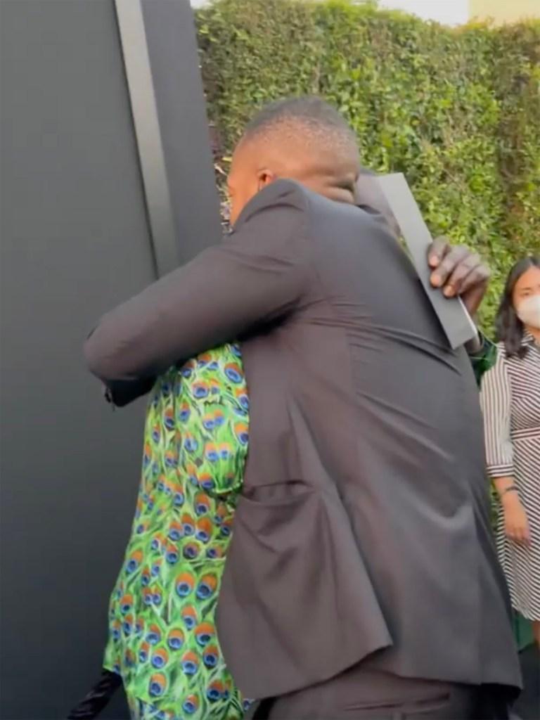 Marlon and Michael hugging.